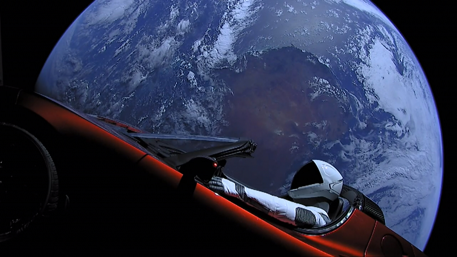 Red convertible car launched into space